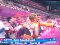 Zonderland and his coach embrace when they see the score