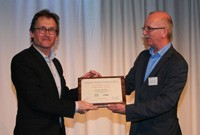 Prof. Ben Feringa receives the certificate form prof. dr. Eelco Vogt.