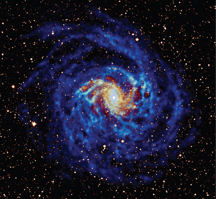 Neutral hydrogen (blue) in the galaxy NGC6946, observed with the Westerbork Synthesis Radio Telescope (WSRT), superposed on an image of the starlight (orange-yellow). Note that the hydrogen is much more extended than the distribution of star light. By: Oosterloo, Boomsma, van der Hulst and Sancisi, Kapteyn Astronomical Institute and ASTRON.