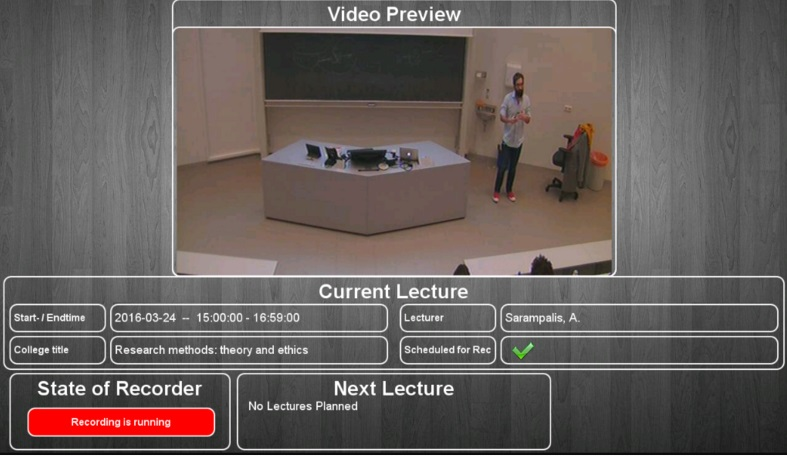 The information panel in the room displays whether the lecture is recorded or not.