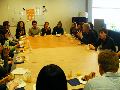 Francis Collins in discussion with young researchers
