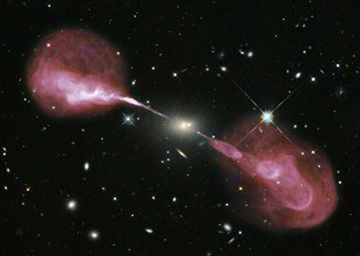 Probably all galaxies have a supermassive black hole (SMBH) in their centre. When the SMBH accrete matter they will produce a jet, which expels part of the inflowing matter. These jets are very prominent in radio and X-ray emission and can be thousand times larger than the galaxy itself. Image credit: NASA, ESA, S. Baum, C. O'Dea, R. Perley, W. Cotton, and the Hubble Heritage Team.