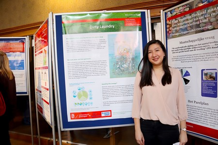 Caecilia Satyawan next to her poster on Dirty Laundry | Photo Science LinX